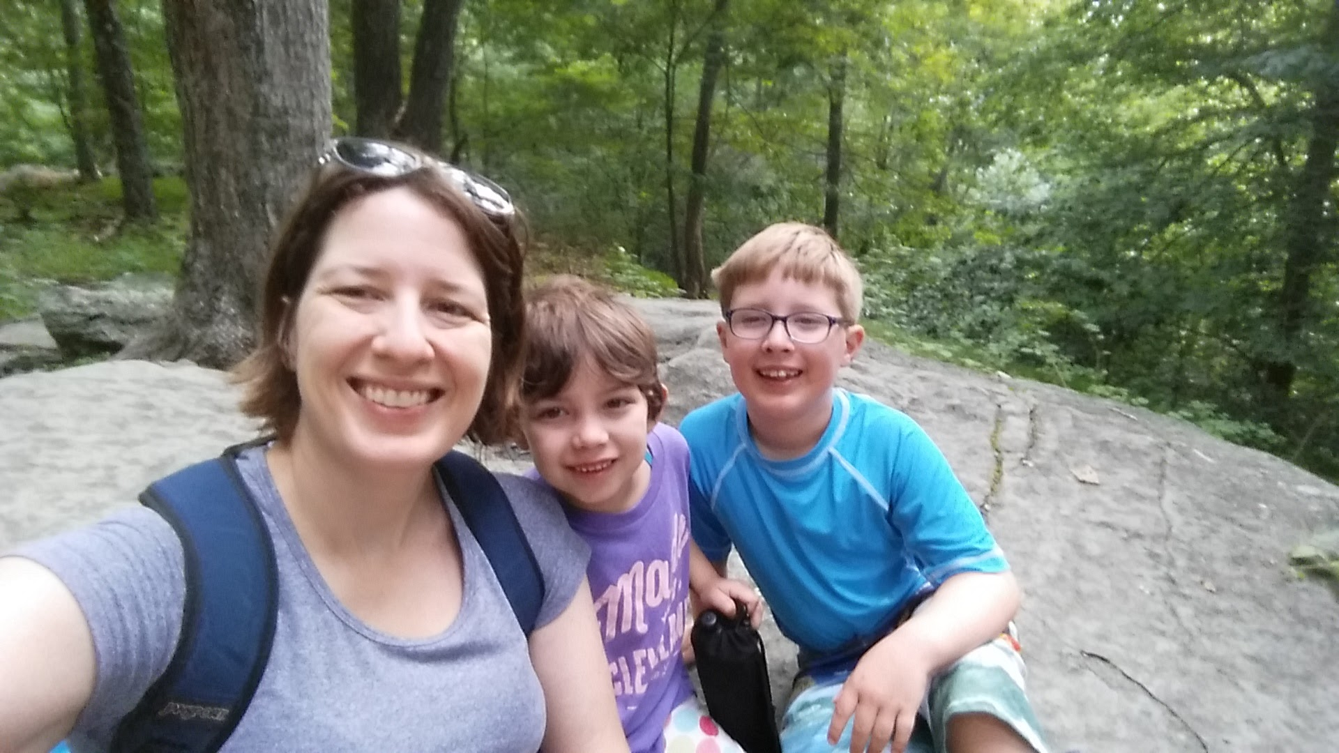 Elizabeth and her kids hiking at Cumberland Falls State Park.